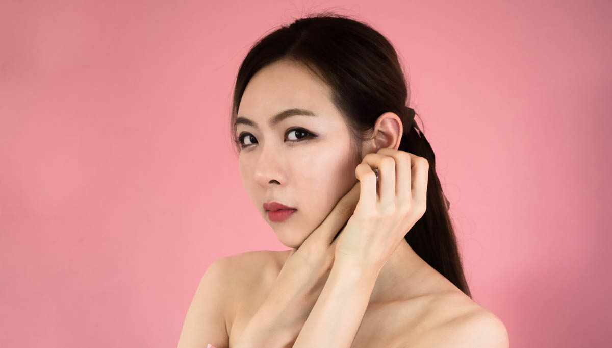 asian woman touch ear otoplasty